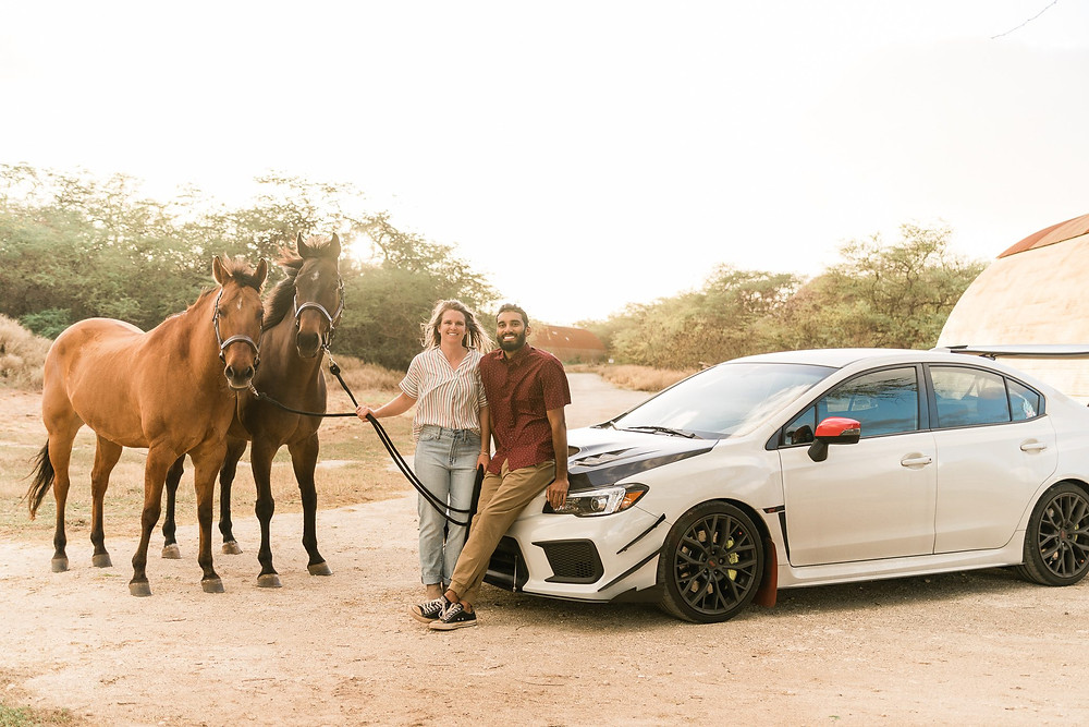 Lindsey and Bilal with both horses and his car