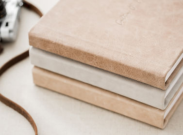 a stack on neutral colored fine art albums