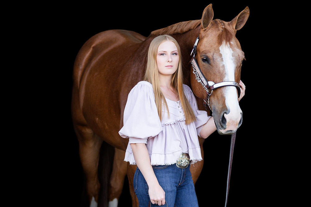 a black background image of Ansley with her APHA gelding, Leo