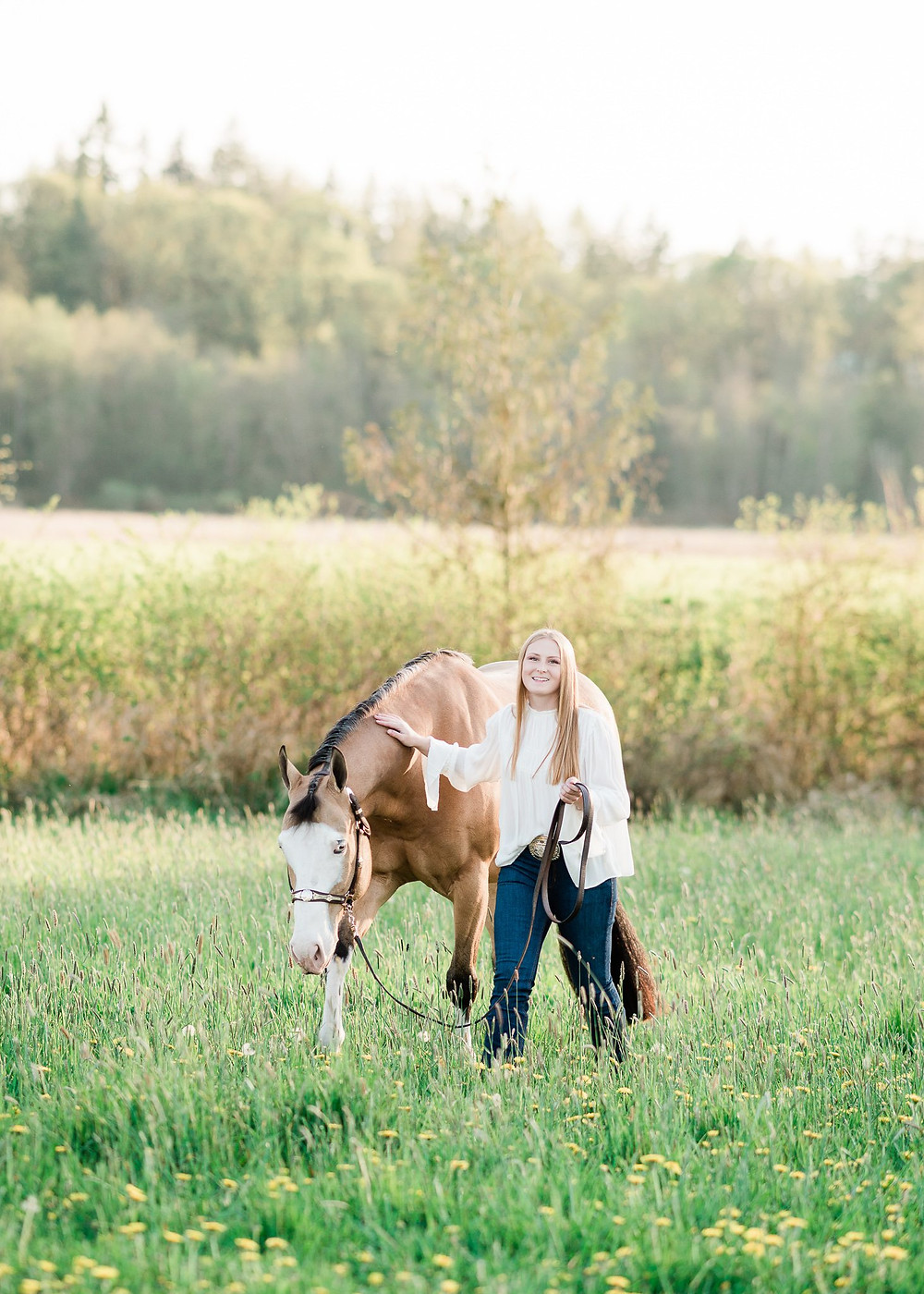 Ansley walking with Shiloh, her APHA gelding, in a grassy spot at Lucky 13 Ranch in Arlington, WA