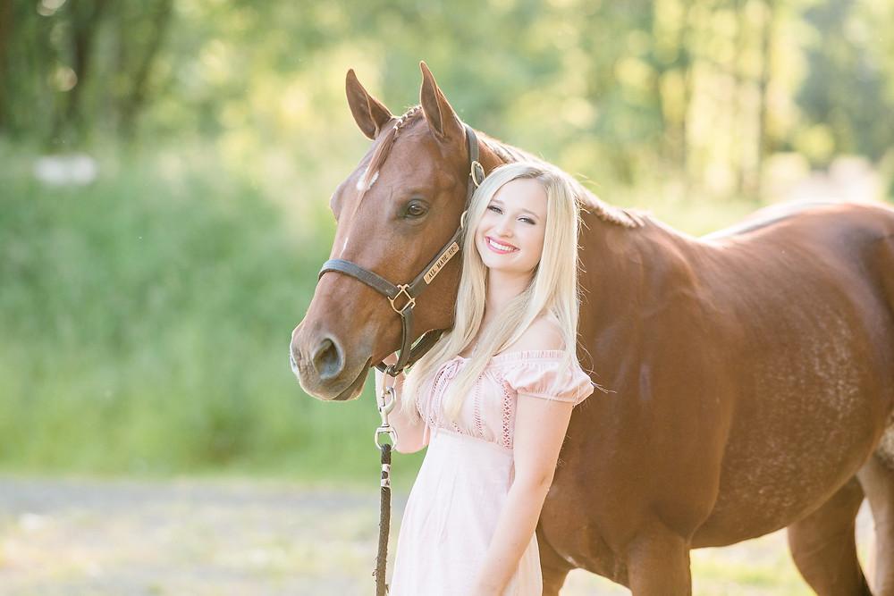 A headshot of Caitlin and her AQHA sorrel mare, Ava