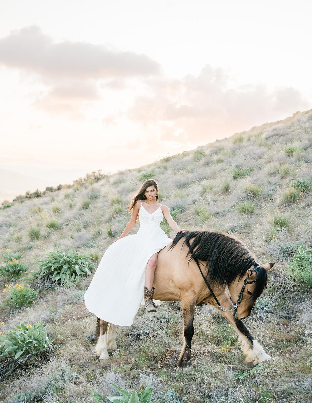 Soli wearing a long white dress, draped over Bubba's back