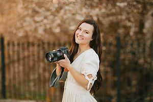 Jeni Brunner of Jeni Jo Photography holding her camera