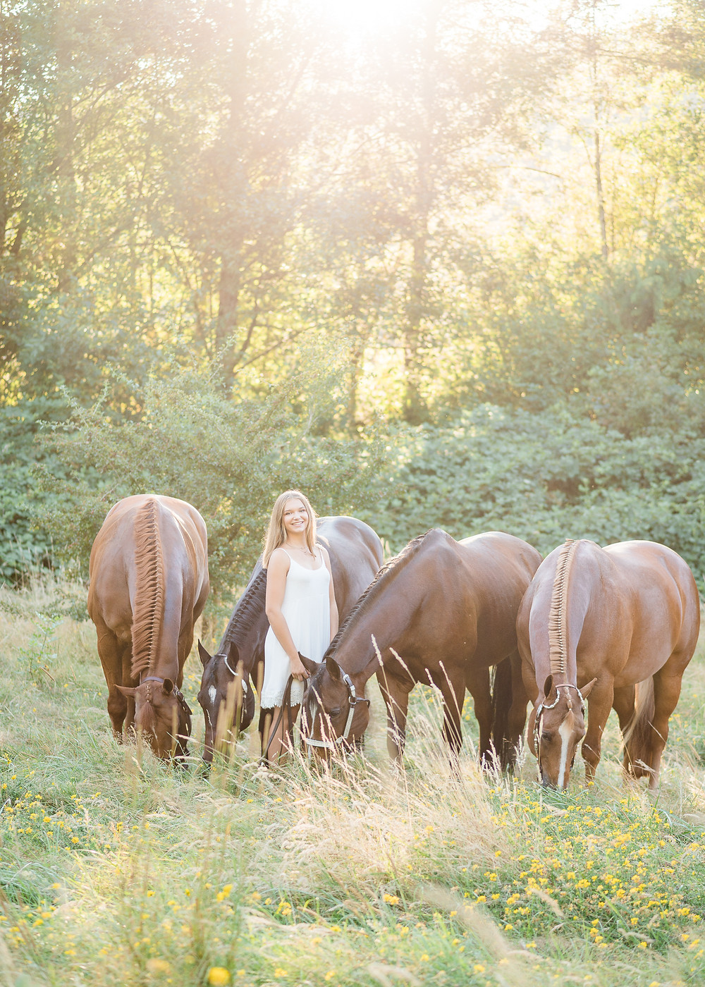 Anya with all four of her horses, Indie, Tex, Belle, and Barbee