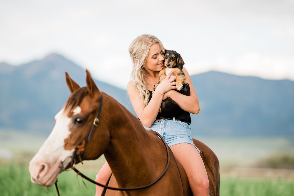 Katie Schols, with her dog, Bonnie and horse, Hank