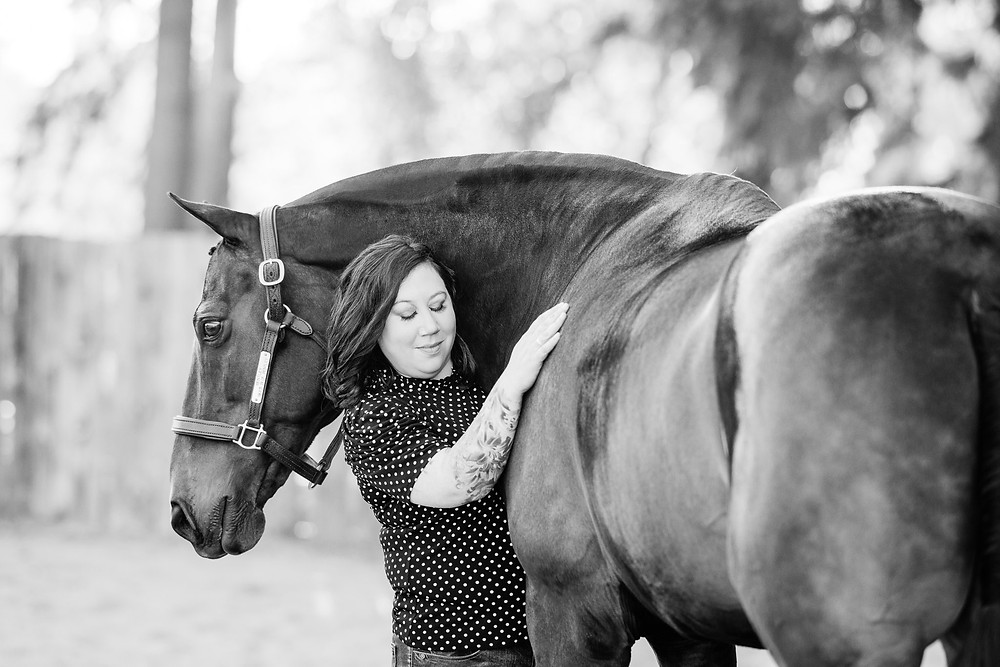 a black and white image of Anne hugging Bentley with her eyes closed