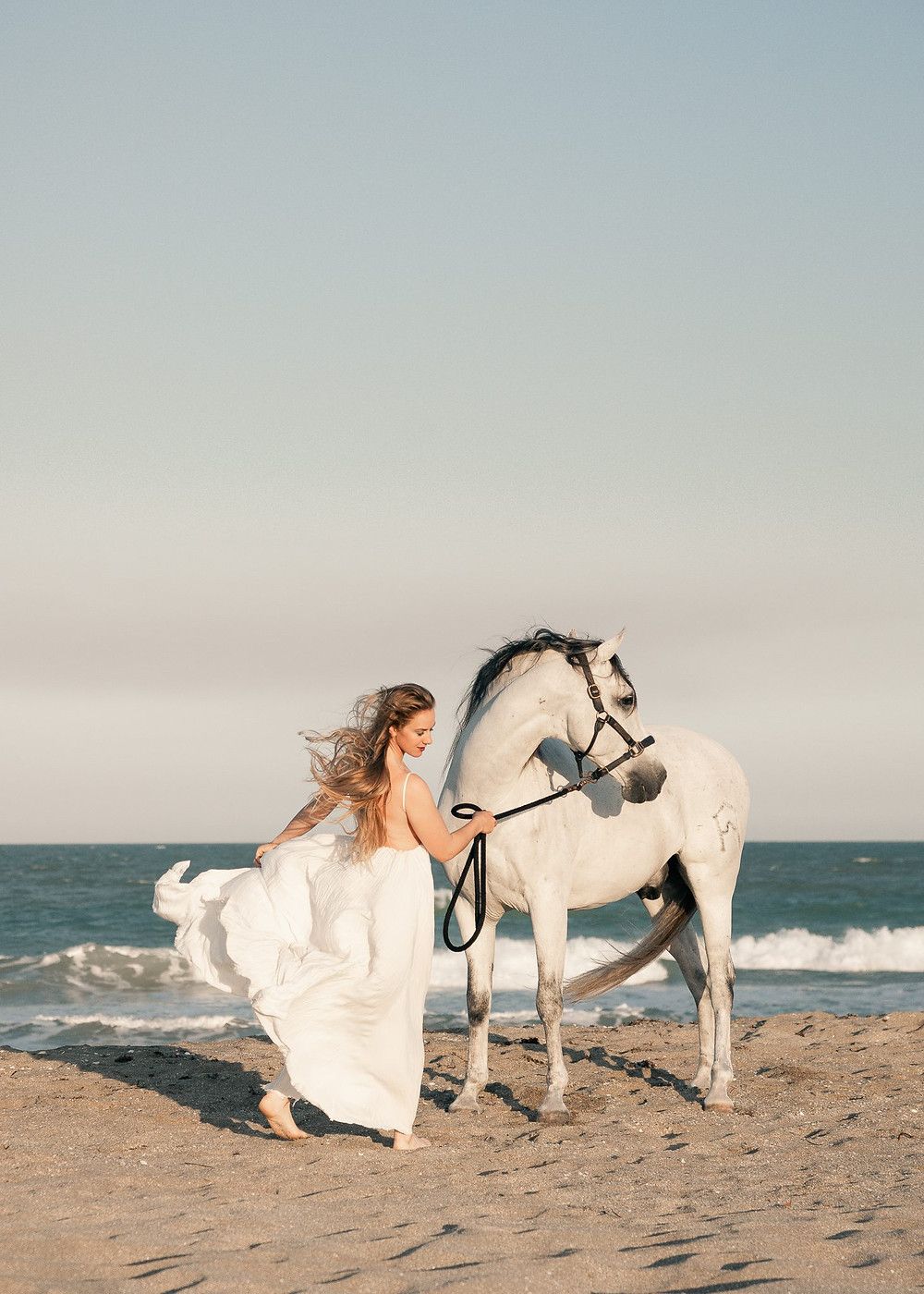 Laura Killian and Devoto, an andalusian gelding on the beach in florida