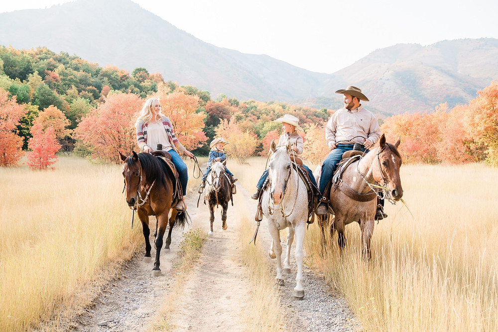 the Anderson family, riding their horses in the Logan valley in Utah in the fall