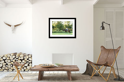 a framed print in a house above a fireplace with neutral colored decor