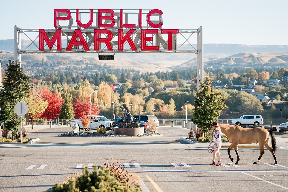 Breanna and her horse, Legs crossing the crosswalk in front of the Pybus Public Market in Wenatchee, Washington