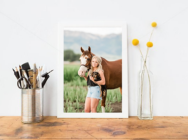 a framed print of a girl holding her dog with her horse standing next to them