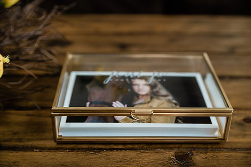 a glass keepsake box inlcuding photos of a girl and her horse from her equestrian session