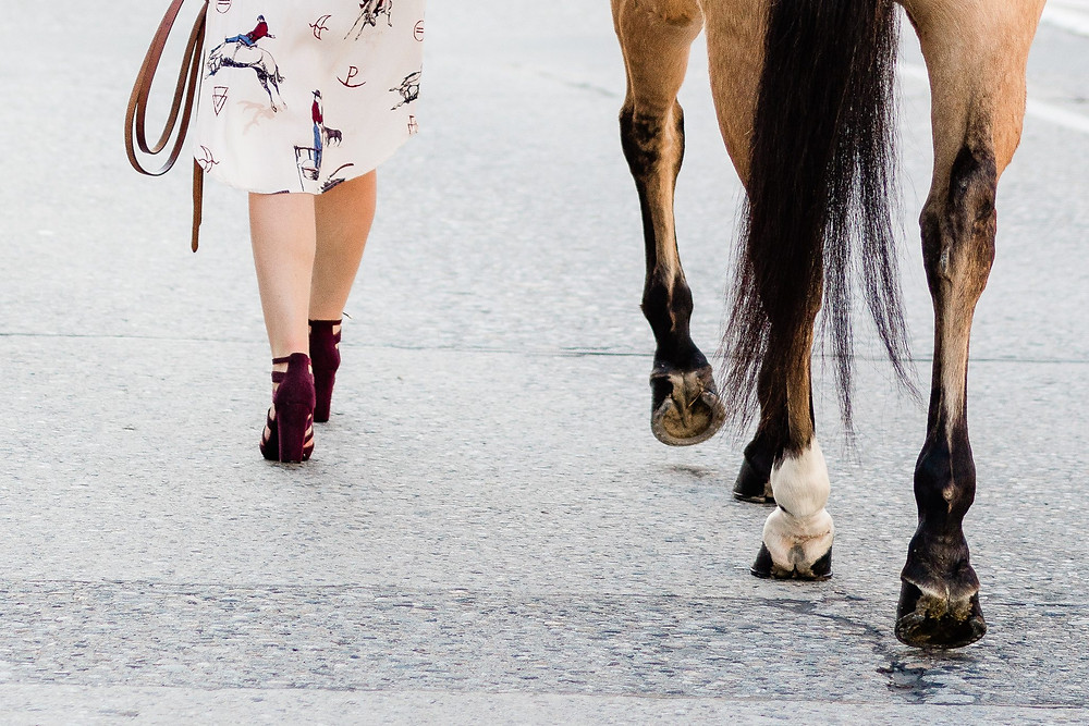 Breanna wearing her West Desperado inspired outfit, walking Legs down the street in Wenatchee