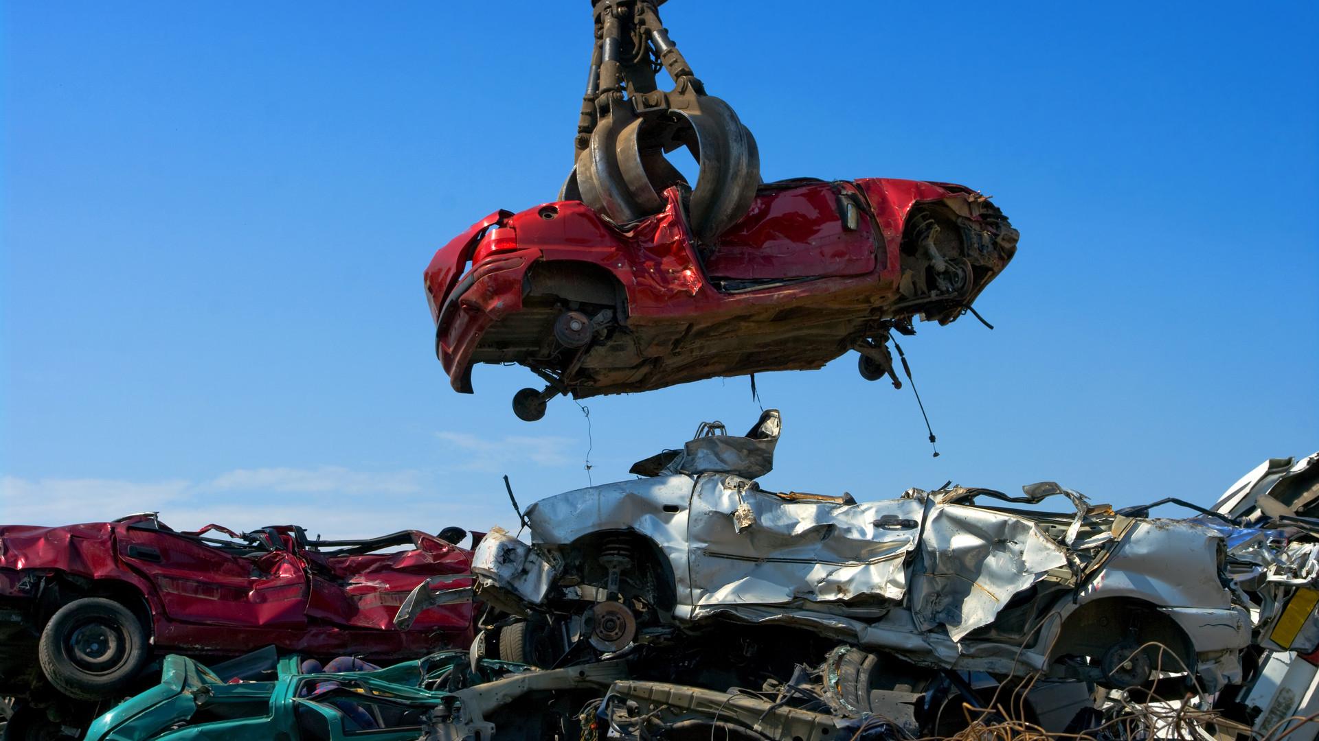 Crane picking up a car in a junkyard.jpg