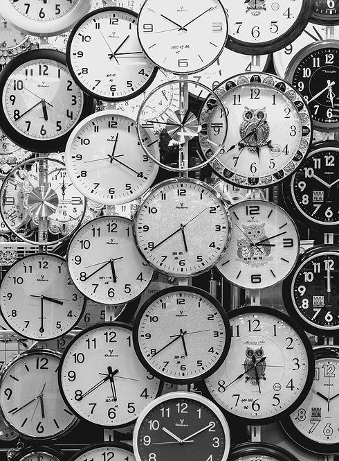black-and-white-photo-of-clocks-707676.j