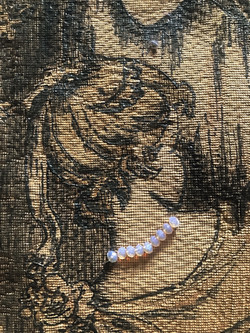 tapestry, lady with neckless