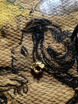 tapestry: lady with earing