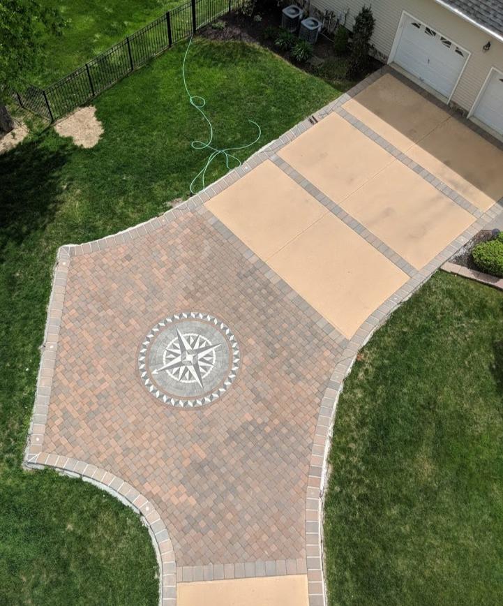 hardscape design, compass rose inlay, designer driveway, paverart, landscape architecture