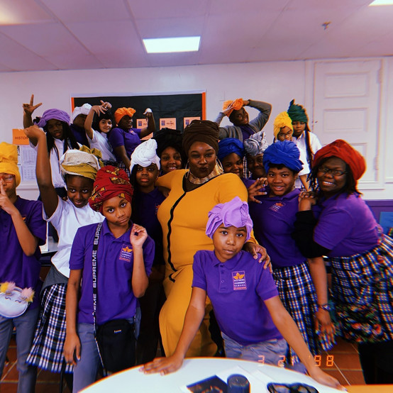 Baltimore Leadership School for Young and education coordinator; Ebony Evans after a headwrapping workshop.