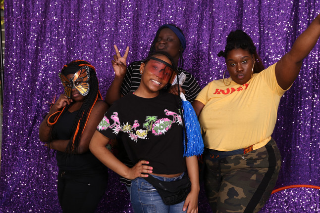 New Song Academy students and Ebony Evans during an end of the year celebration