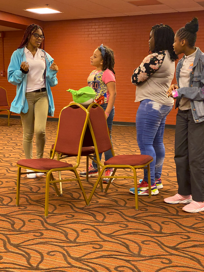 GWCC students engaging in a Improv scene at the Modell-Lyric