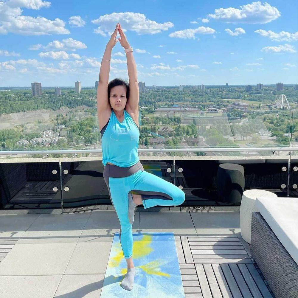 Young cancer survivor doing yoga