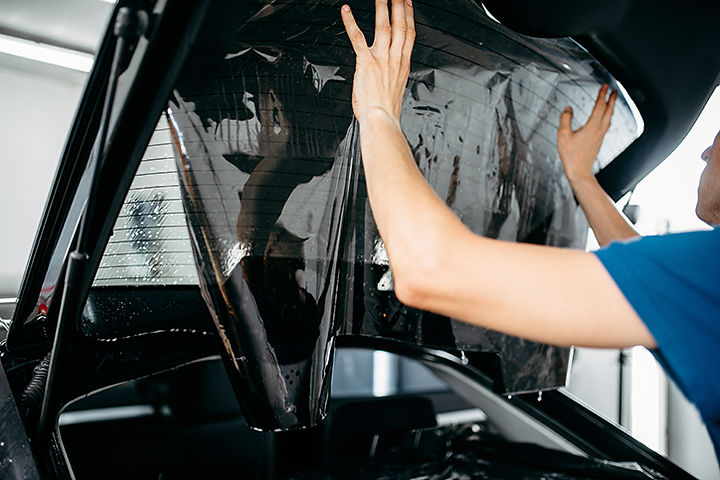male-worker-applying-car-tinting-film-PA