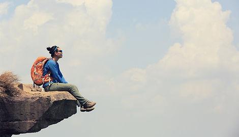 hiker-sitting-cliff.jpg