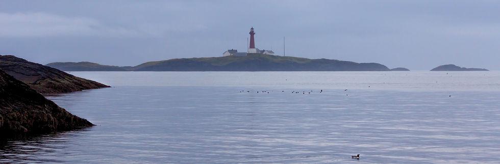 Skomvær Lighthouse and calm sea on Røst in Lofoten