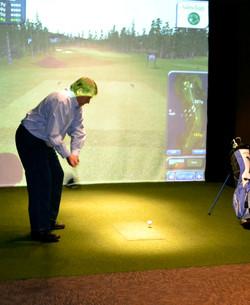 Having fun at our indoor golf sim
