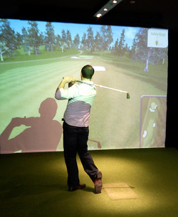 Playing a round on our golf sim