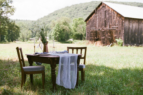 romantic barn wedding table farm field