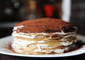 Crepe cake with tiramisu filling dusted