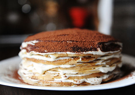 Crepe cake with tiramisu filling dusted