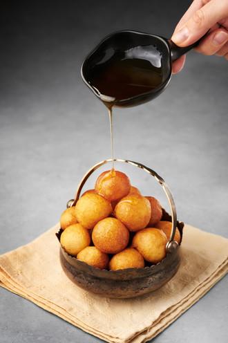 Loukoumades or lokma with honey syrup
