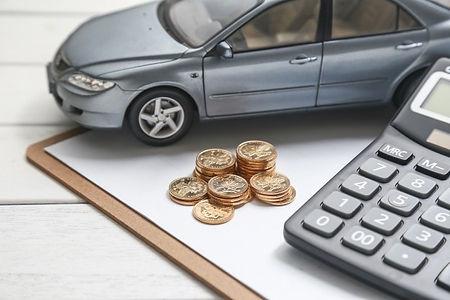 car-model-calculator-coins-white-table_1