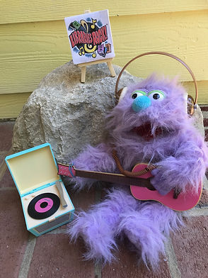 puppet playing guitar for puppet show