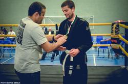 Chris receiving a medal