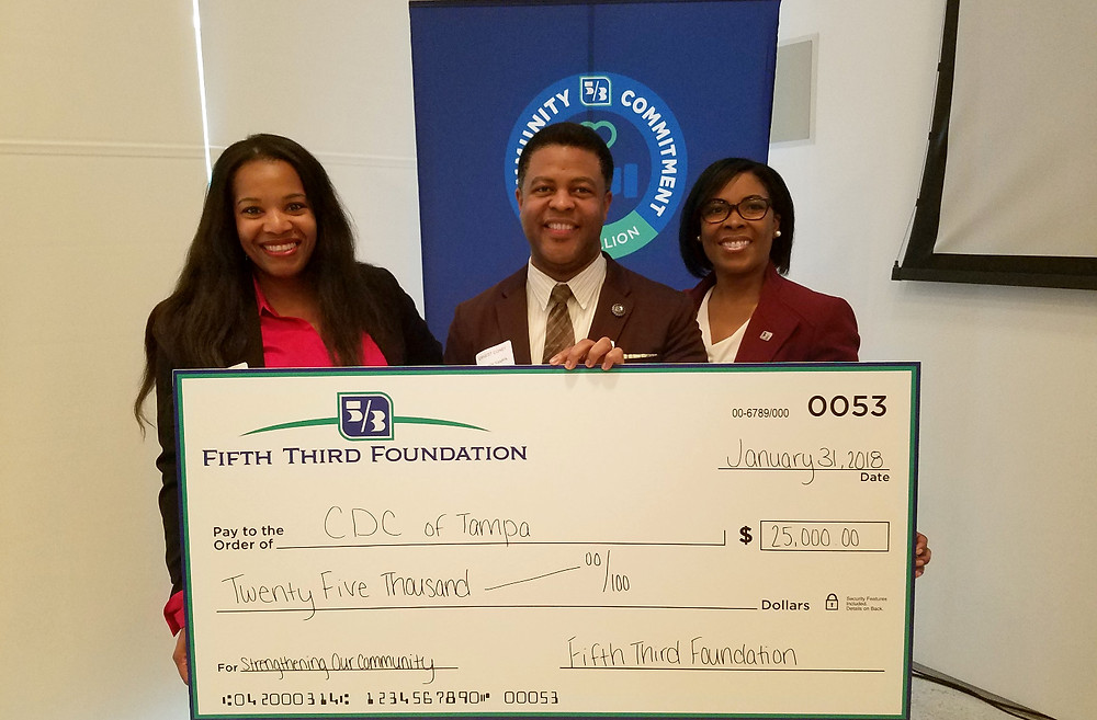 CDC of Tampa Board Chair Krys Patterson and CEO Ernest Coney Jr. accept the grant award from Fifth Third