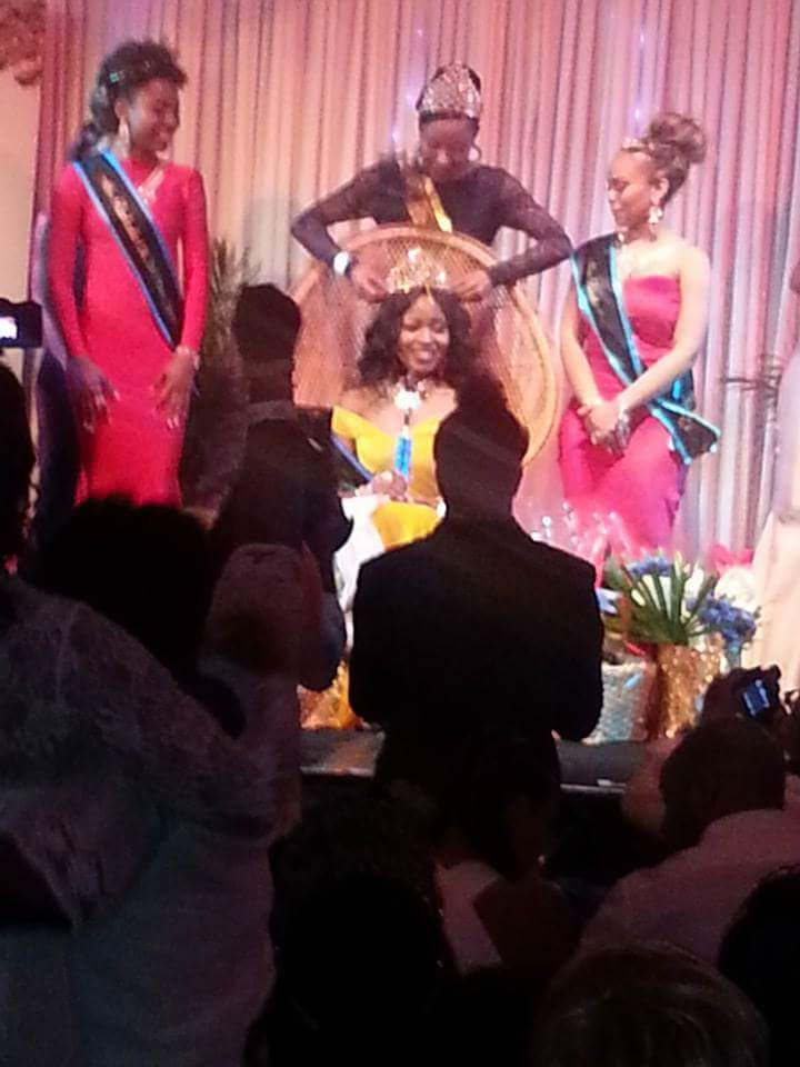 Miss Caribbean UK's Keeleigh Griffit placing the crown on the winner of Miss Barbados UK