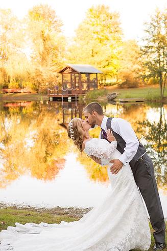 bride groom kiss by lake