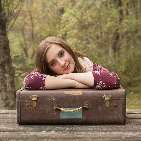 senior girl with suitcase