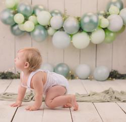 Green balloon garland