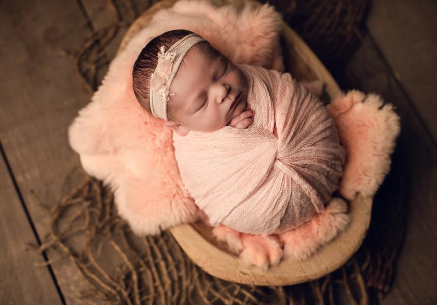 baby girl in bowl