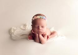 Baby girl holding head