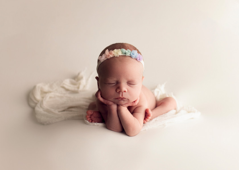 baby girl in froggy pose