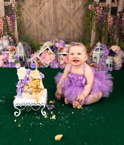purple floral themed cake smash