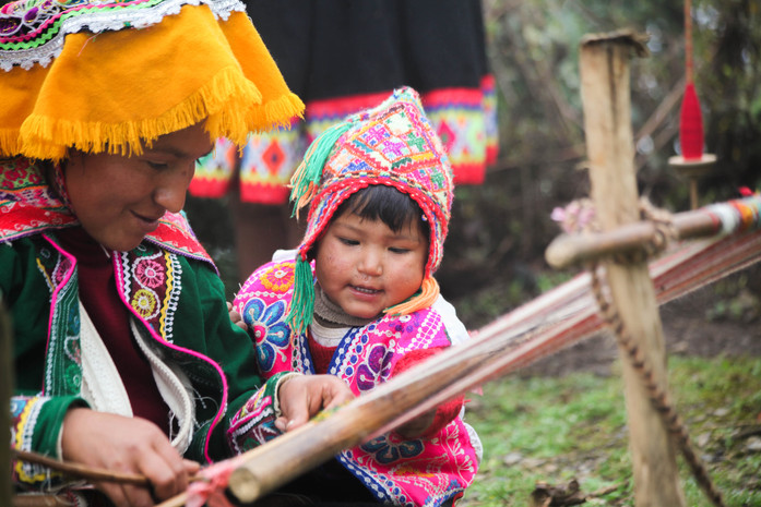 Anderson learning the art of backstrap weaving from his mom, Roxana. Parobamba, Peru.