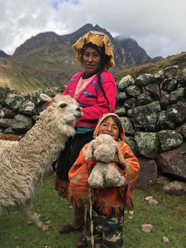 Alpaca-herder Dorotea and her son, Elisban. Cancha Cancha, Peru.