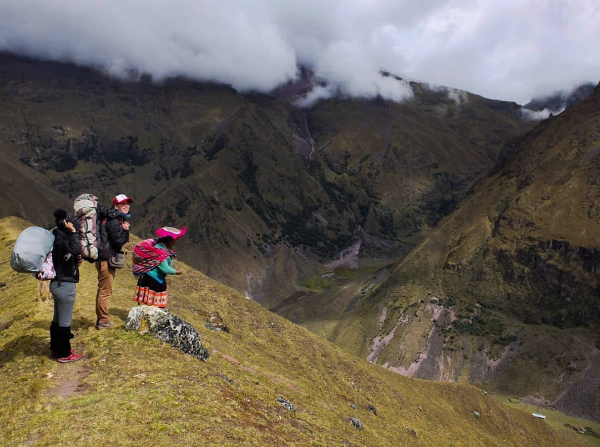 Ashli and the Mosqoy team hiking in the Andean mountains to register alpacas.